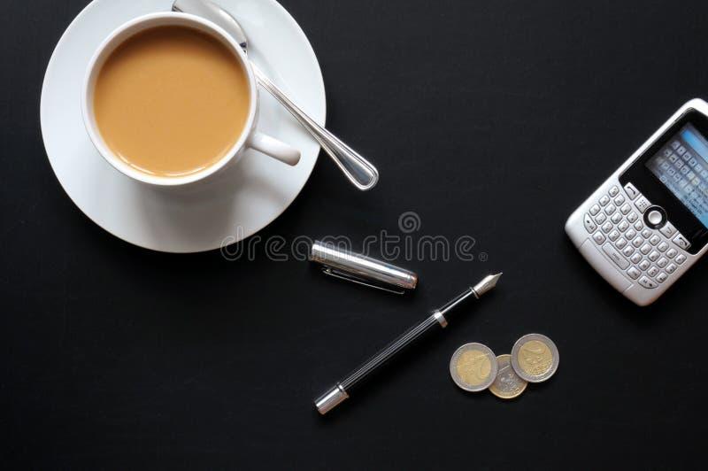咖啡纸笔电话 库存图片