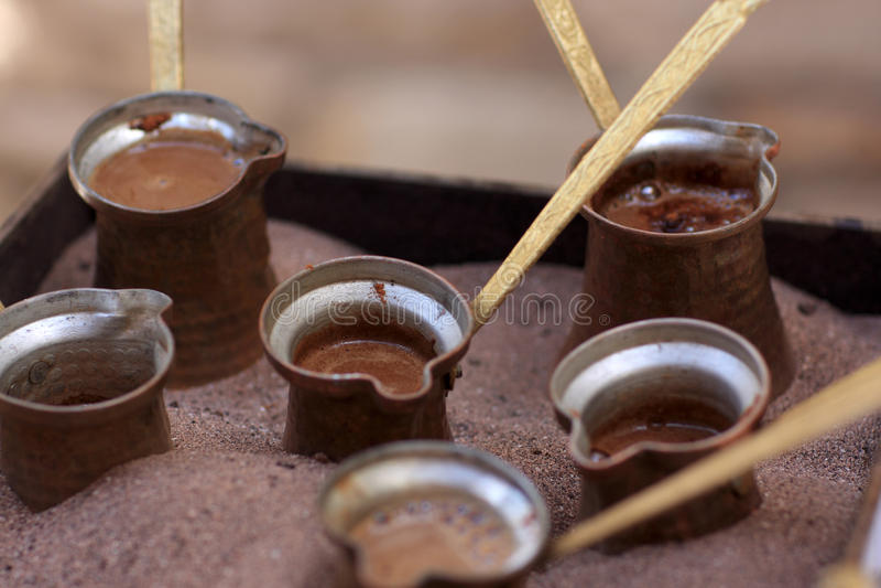 咖啡罐沙子 图库摄影