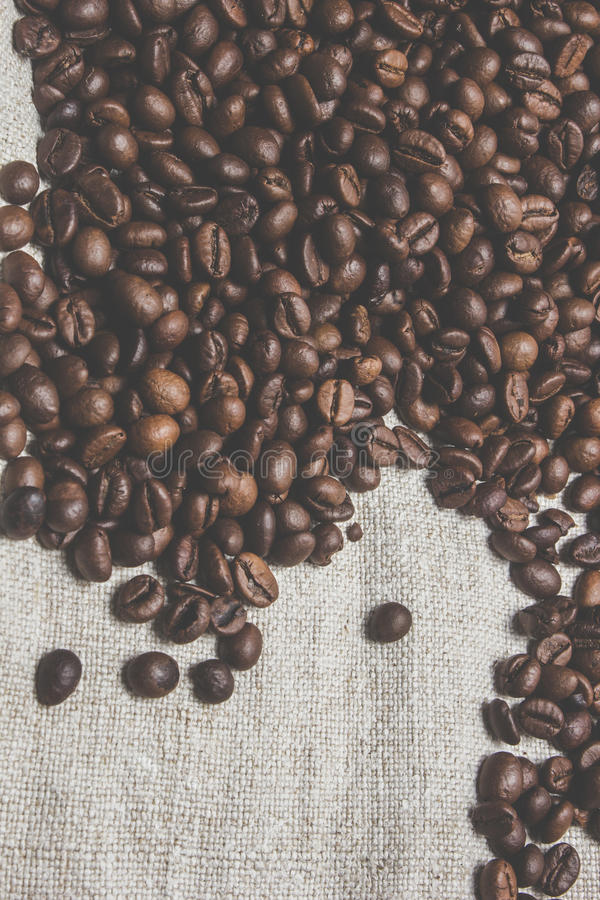 咖啡豆,粗麻布 免版税库存照片