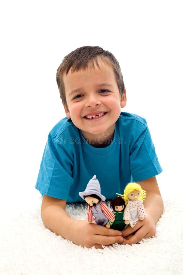 咧嘴笑的愉快的孩子缺少牙 免版税库存图片
