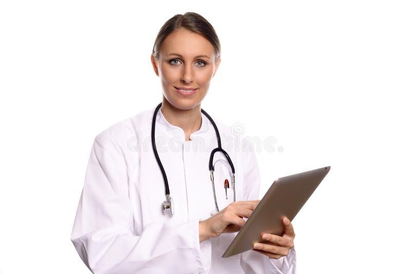 咨询片剂计算机的护士或医生 库存图片