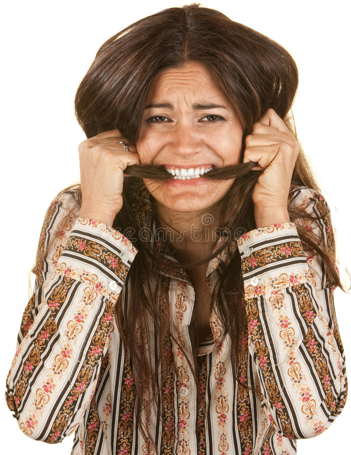 咬住她的头发的狂热妇女 免版税图库摄影