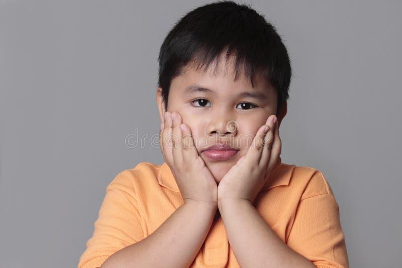 哀伤亚洲的孩子非常 免版税库存照片