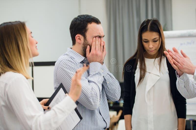 哀伤和沮丧的商人在会议期间 免版税库存图片
