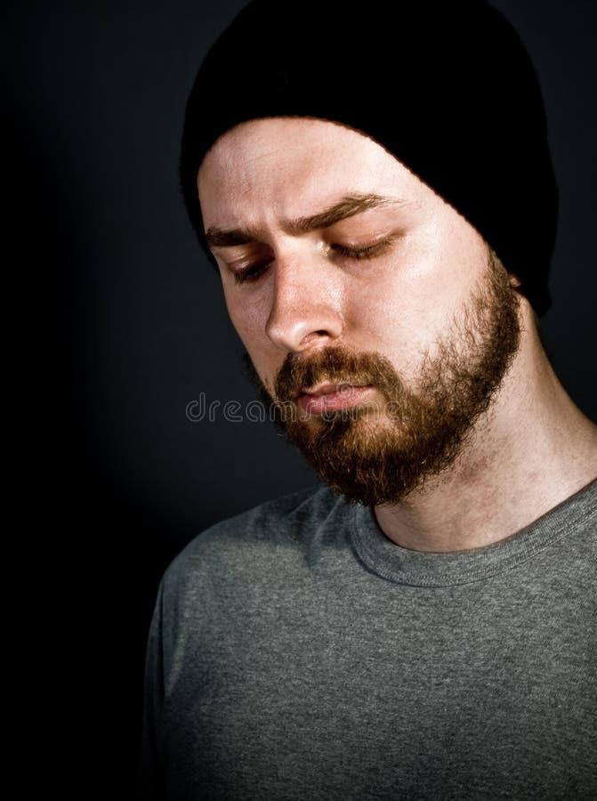 哀伤有胡子的grunge人一的纵向 库存图片