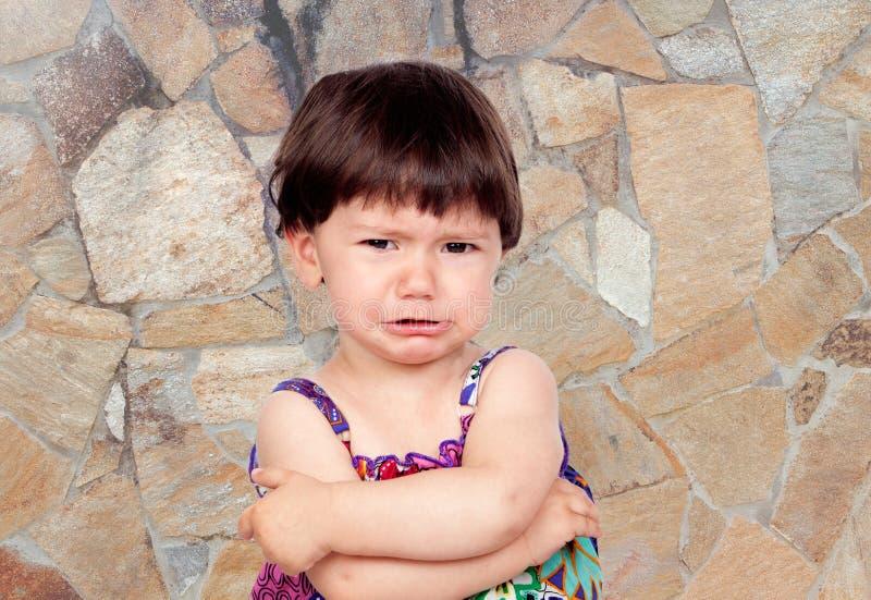哀伤的女婴 免版税库存图片