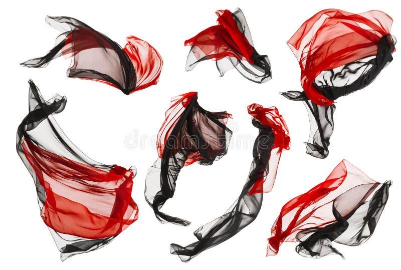 织品布料流程和波浪,在白色的被折叠的缎飞行红色黑色 库存照片