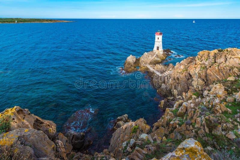 品柱耶老岛的灯塔在撒丁岛,意大利 库存照片