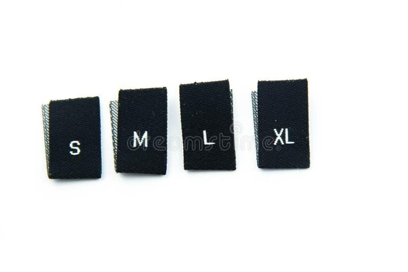 黑织品衣物大小标签 库存图片