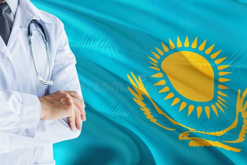 哈萨克人与听诊器的医生身分在哈萨克斯坦旗子背景 全国卫生保健系统概念,医疗题材 免版税库存图片