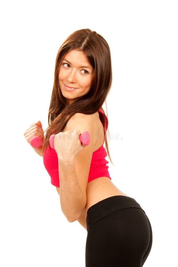哑铃执行健身衡量妇女 免版税图库摄影