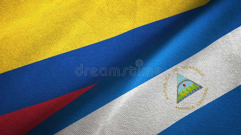 哥伦比亚和尼加拉瓜两旗子纺织品布料,织品纹理 皇族释放例证
