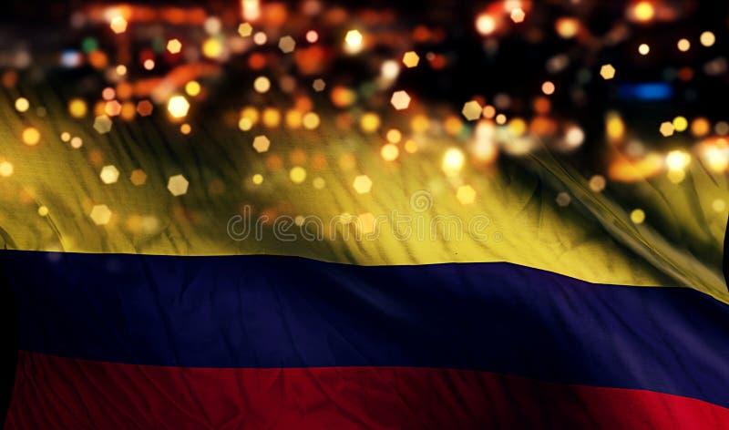哥伦比亚国旗光夜Bokeh摘要背景 免版税库存图片