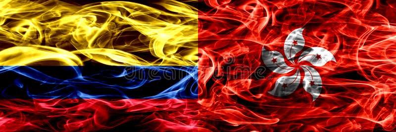 哥伦比亚对香港,中国烟旗子肩并肩安置了 哥伦比亚和香港,中国厚实的色的柔滑的烟旗子  库存例证
