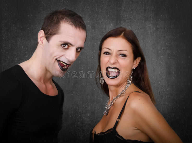 哥特式夫妇微笑 免版税库存图片