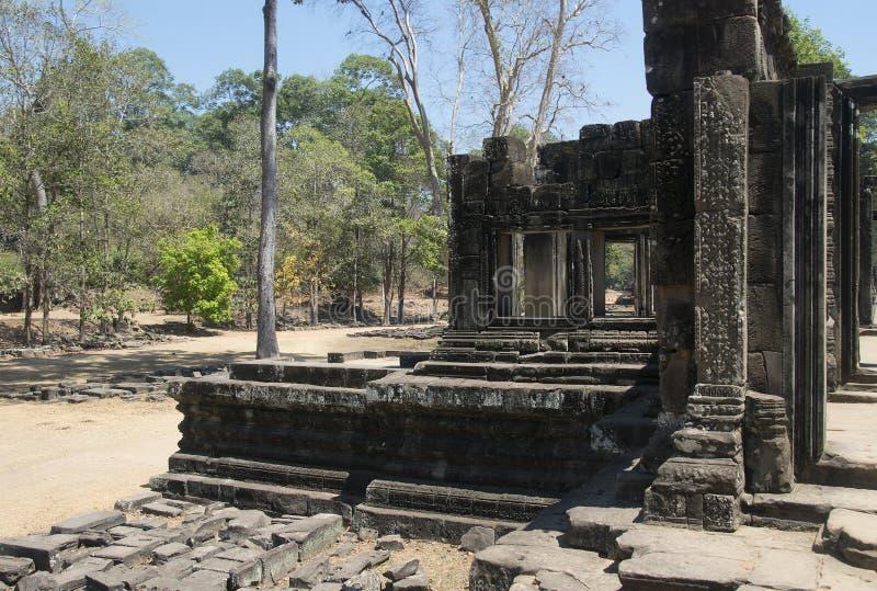 吴哥瓦特- Ta Prohm高棉市的寺庙废墟墙壁吴哥窟-陈述纪念碑 免版税库存照片