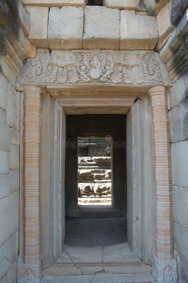 吴哥瓦特- Ta Prohm高棉市的寺庙废墟墙壁吴哥窟-陈述纪念碑 免版税库存图片