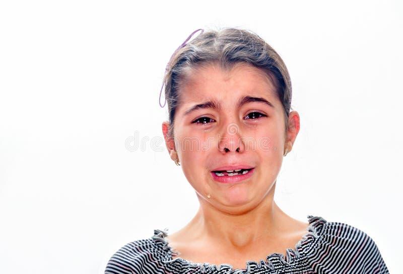 哭泣与泪花的小女孩滚动下来她的面颊隔绝了o 库存图片