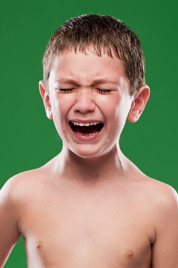 哭泣充满痛苦的孩子 免版税库存图片