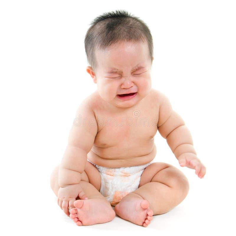 哭泣的亚裔婴孩 库存照片