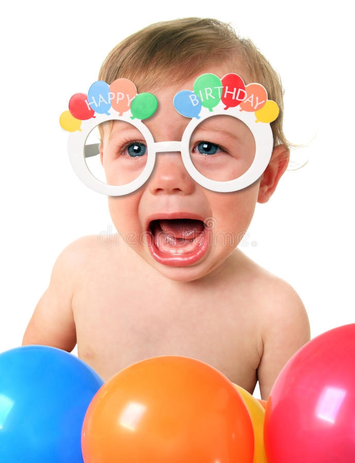 哭泣的生日婴孩 免版税图库摄影