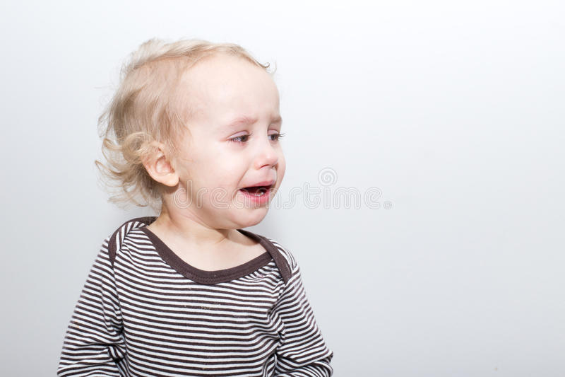 哭泣的男孩画象  图库摄影