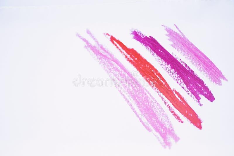 唇膏冲程概念 在白色隔绝的被弄脏的唇膏的汇集 专家的唇膏组成 嘴唇关心 库存图片