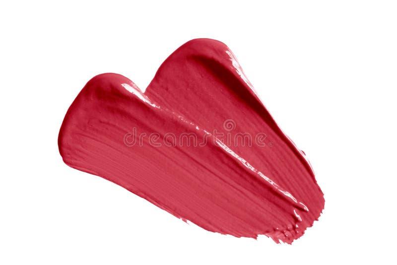 唇膏样片在白色背景隔绝的污点污迹 奶油色构成纹理 明亮的红色化妆品刷子冲程 免版税库存照片