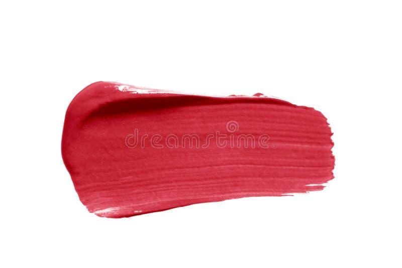 唇膏污点在白色背景隔绝的污迹样片 奶油色构成纹理 明亮的红色化妆品刷子冲程 免版税库存图片