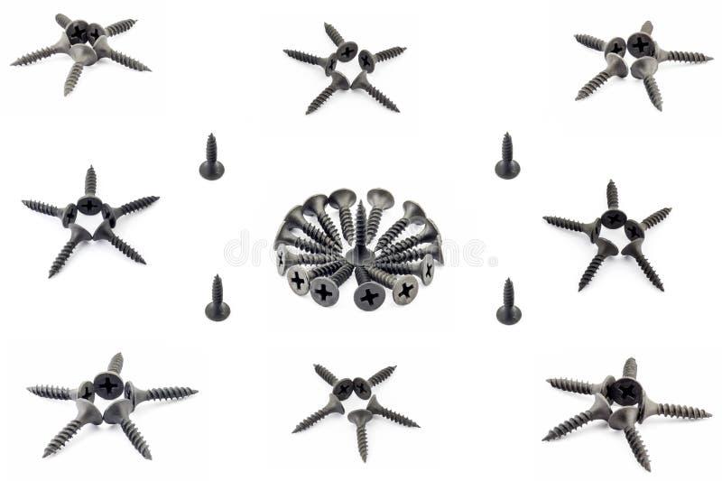 唯一八个的星四和与黑色的onecircular构成氧化了在白色背景隔绝的自动攻丝螺杆 库存照片