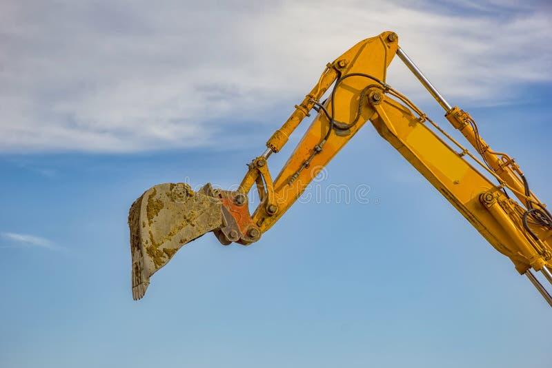 唯一挖掘机景气胳膊 免版税库存图片