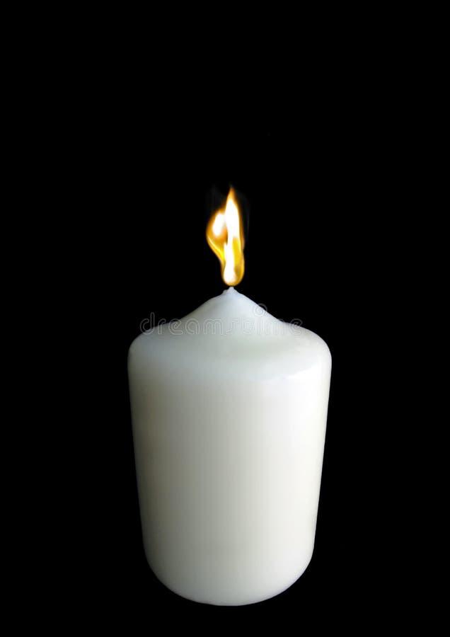 唯一灼烧的蜡烛 免版税库存图片