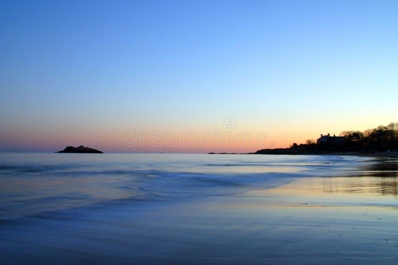 唱歌海滩日落的储蓄图象 免版税库存照片