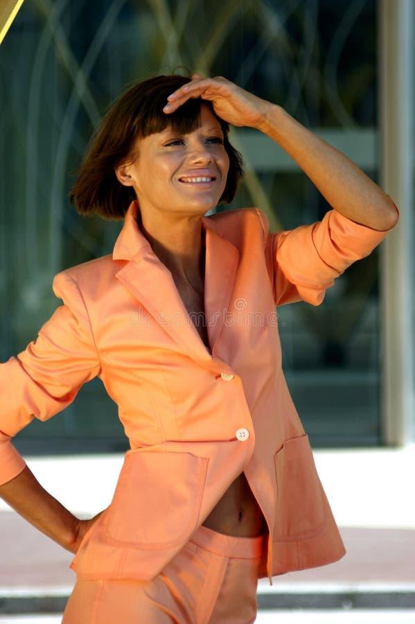 商业上色了奶油色礼服妇女新 库存图片