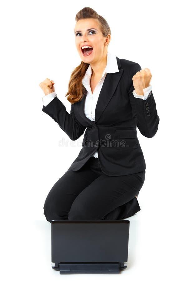 商业激发她的欣喜成功妇女 库存照片