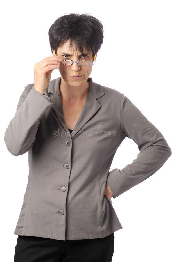 商业生气的玻璃查找在妇女的她 库存图片