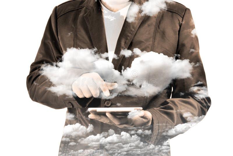 商人两次曝光使用有Clou的流动片剂个人计算机 免版税库存图片