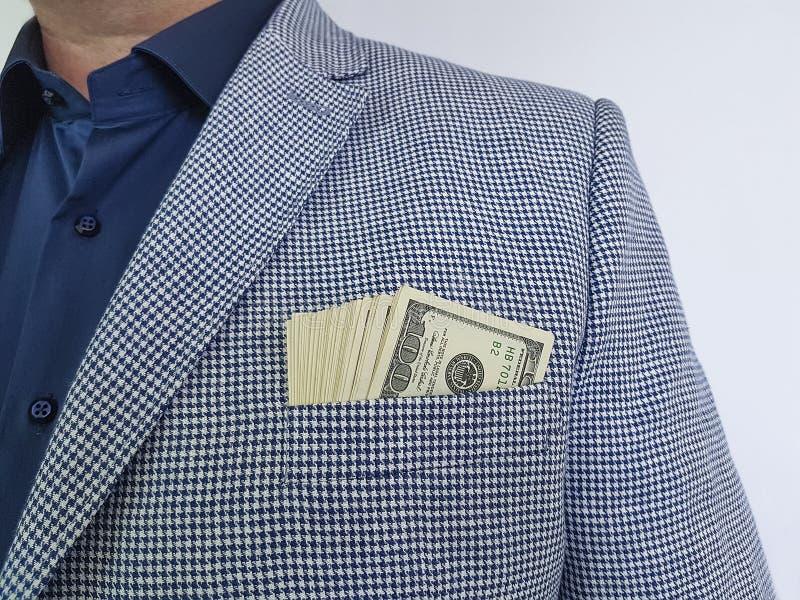 商人以在正式口袋的特写镜头的衣服美元 库存照片