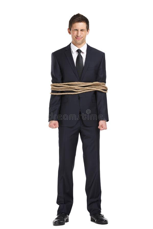商人全长画象栓与绳索 免版税库存图片