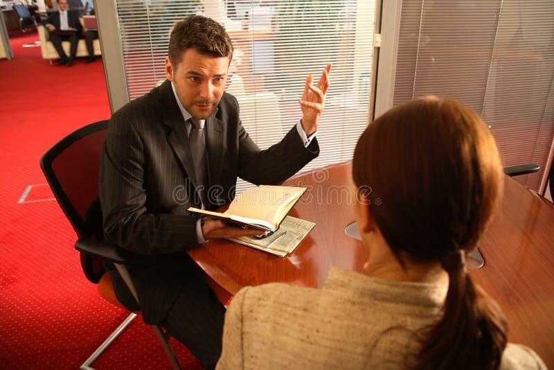商人办公室联系的妇女 库存图片