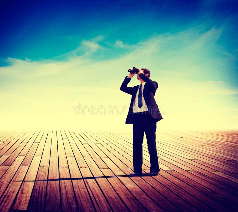 商人单独看探索搜寻风景概念 库存图片