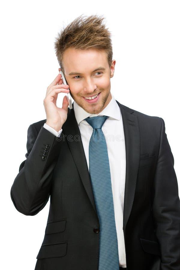 商人发表演讲关于手机 免版税库存照片