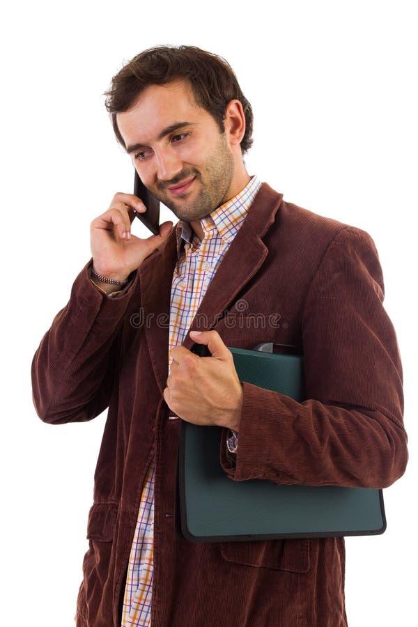 商人发表演讲关于手机 免版税图库摄影