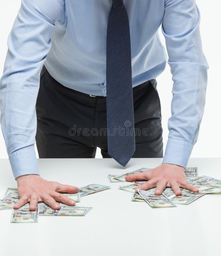 商人合适的金钱 免版税库存图片