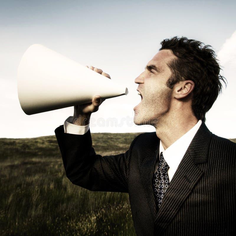 商人呼喊的扩音机领域概念 免版税库存图片