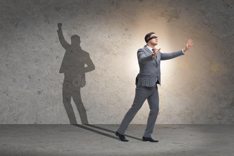 商人和他的阴影在企业概念 库存照片