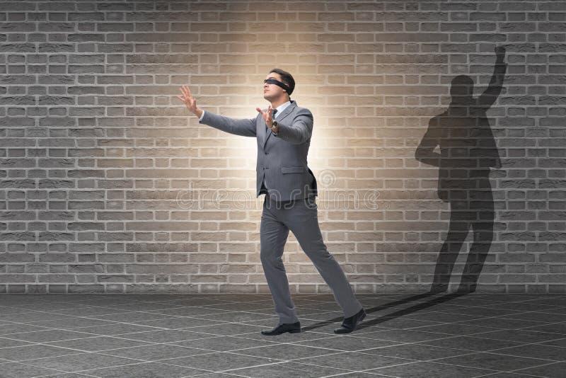 商人和他的阴影在企业概念 图库摄影