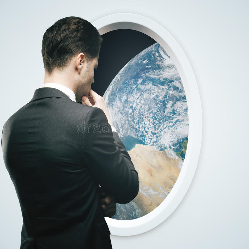 商人和光太空飞船窗口 免版税图库摄影