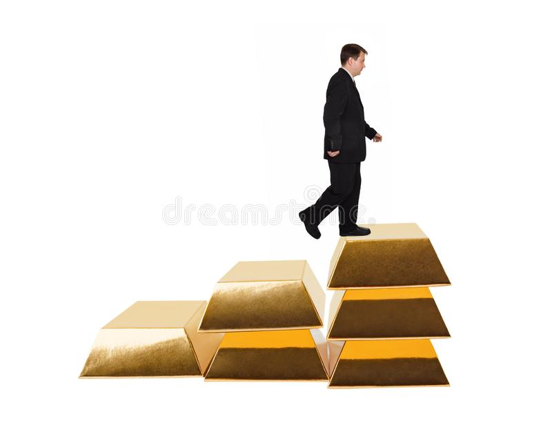 商人和台阶由金制马上的齿龈做成 免版税库存照片