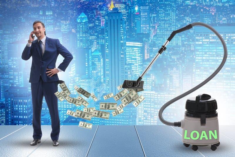 商人和吮金钱的吸尘器在他外面 免版税库存照片